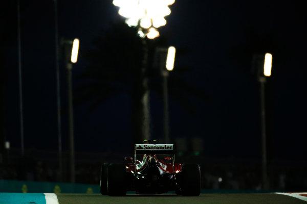 Yas Marina Circuit, Abu Dhabi, United Arab Emirates. Saturday 22 November 2014. Kimi Raikkonen, Ferrari F14T.  World Copyright: Glenn Dunbar/LAT Photographic. ref: Digital Image _W2Q5689