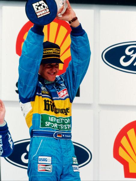 Interlagos, Sao Paulo, Brazil.24-26 March 1995.Michael Schumacher (Benetton Renault) 1st position on the podium.Ref-95 BRA 03.World Copyright - LAT Photographic