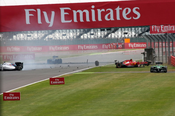 Kimi Raikkonen (FIN) Ferrari F14 T crashed on lap one and was collected by Felipe Massa (BRA) Williams FW36, bringing out the red flag for barrier repairs. Formula One World Championship, Rd9, British Grand Prix, Race Day, Silverstone, England, Sunday 6 July 2014.