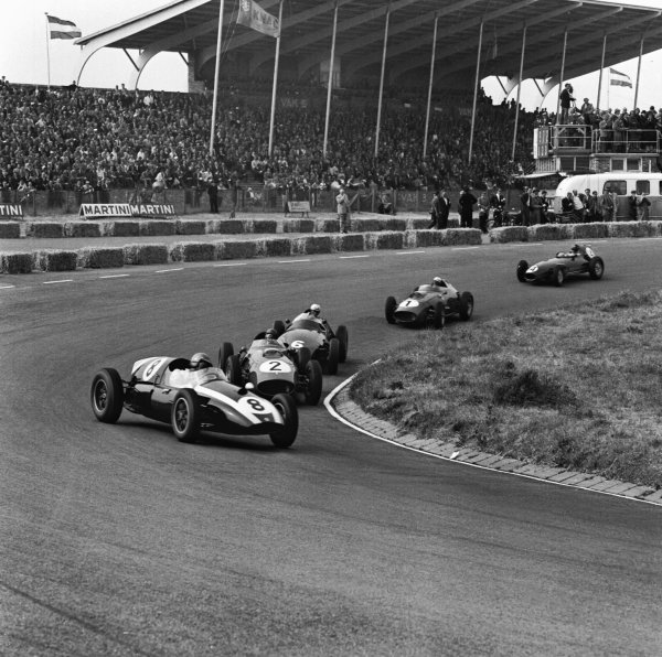 Zandvoort, Holland. 31st May 1959.Jack Brabham (Cooper-Climax T51), 2nd position leads Tony Brooks (Ferrari Dino 246), retired, and Harry Schell (BRM 25), retired, action. World Copyright: LAT Photographic.Ref:  4107