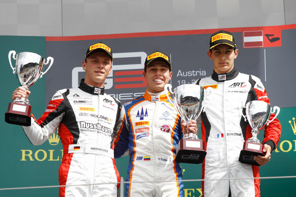 2015 GP3 Series Round 2.  Red Bull Ring, Spielberg, Austria.  Sunday 21 June 2015. Oscar Tunjo (COL, Trident) celebrates his win on the podium with Marvin Kirchhofer (GER, ART Grand Prix) and Esteban Ocon (FRA, ART Grand Prix). Photo: Sam Bloxham/GP3 Media Service  ref: Digital Image _G7C5926