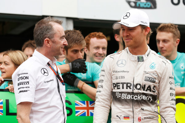 Monte Carlo, Monaco. Sunday 24 May 2015. Paddy Lowe, Executive Director (Technical), Mercedes AMG, and Nico Rosberg, Mercedes AMG, 1st Position, celebrate victory with their team. World Copyright: Alastair Staley/LAT Photographic. ref: Digital Image _R6T2526