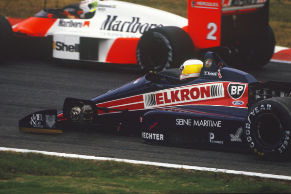 1987 Japanese Grand Prix  Suzuka, Japan. 29th October - 1st November 1987.  Yannick Dalmas, Larrousse Lola LC87 Ford, missing his front left wheel, is passed by Stefan Johansson, McLaren MP4-3 TAG.  Ref: 87JAP03. World Copyright: LAT Photographic