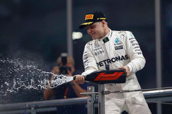 Yas Marina Circuit, Abu Dhabi, United Arab Emirates. Sunday 26 November 2017. Valtteri Bottas, Mercedes AMG, on the podium. World Copyright: Glenn Dunbar/LAT Images  ref: Digital Image _X4I9870