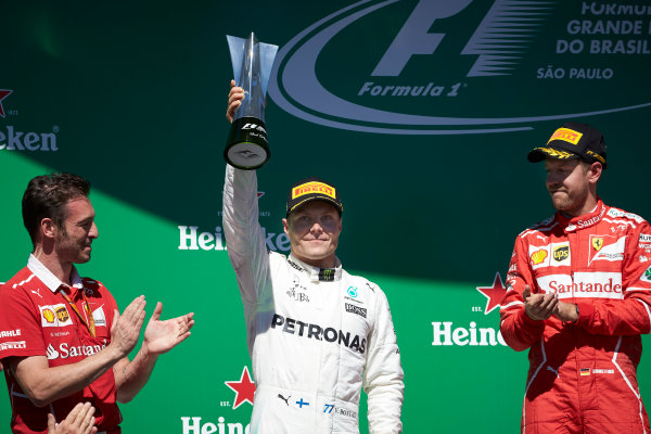 Interlagos, Sao Paulo, Brazil. Sunday 12 November 2017. Valtteri Bottas, Mercedes AMG, 2nd Position, holds up his trophy on the podium. World Copyright: Steve Etherington/LAT Images  ref: Digital Image SNE17432
