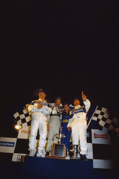 Sebring 12 Hours, Florida, USA. 16th March 1991. Rd 3. Geoff Brabham / Derek Daly / Gary Brabham (Nissan NPT-90), 1st position, podium, portrait.  World Copyright: Bill Murenbeeld/LAT Photographic. Ref:  91IMSA SEB 11.