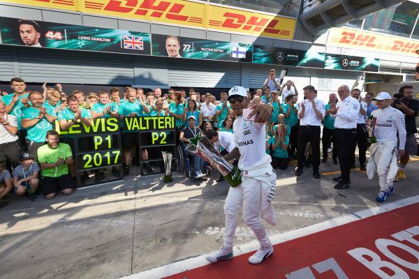 Autodromo Nazionale di Monza, Italy. Sunday 3 September 2017. Lewis Hamilton, Mercedes AMG, 1st Position, celebrates victory with the Mercedes team. World Copyright: Steve Etherington/LAT Images  ref: Digital Image SNE15455