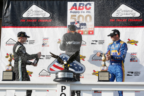 Verizon IndyCar Series ABC Supply 500 Pocono Raceway, Long Pond, PA USA Sunday 20 August 2017 Will Power, Team Penske Chevrolet, Josef Newgarden, Team Penske Chevrolet, Alexander Rossi, Curb Andretti Herta Autosport with Curb-Agajanian Honda celebrate with champagne on the podium World Copyright: Phillip Abbott LAT Images ref: Digital Image abbott_pocono_0817_8081