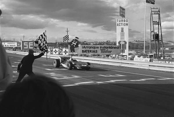 1970 Spanish Grand Prix. Jarama, Madrid, Spain. 17th - 19th April 1970. Jackie Stewart (March 701-Ford), 1st position, crosse the finish line and takes the chequered flag, action.  World Copyright: LAT Photographic. Ref:  2999 - 41.