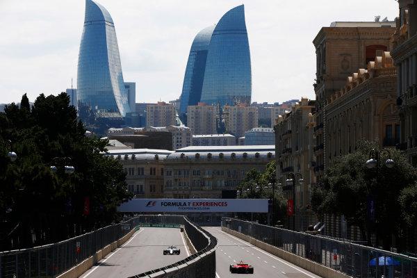 Baku City Circuit, Baku, Azerbaijan. Friday 23 June 2017. Felipe Massa, Williams FW40 Mercedes, and Kimi Raikkonen, Ferrari SF70H, drive down opposing sides of a carriageway.  World Copyright: Andy Hone/LAT Images ref: Digital Image _ONY8348