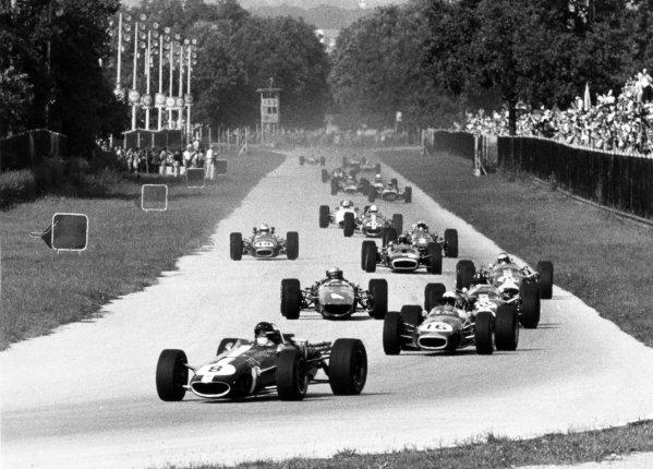 1967 Italian Grand Prix.Monza, Italy. 10 September 1967.Dan Gurney, Eagle AAR104-Weslake, retired, leads Jack Brabham, Brabham BT24-Repco, 2nd position, Graham Hill, Lotus 49-Ford, retired, Bruce McLaren, McLaren M5A-BRM, retired, Jim Clark, Lotus 49-Ford, 3rd position, Jackie Stewart, BRM P83, retired, Denny Hulme, Brabham BT24-Repco, retired, and Chris Amon, Ferrari 312, 7th position, action.World Copyright: LAT PhotographicRef: Motor b&w print