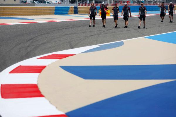 Bahrain International Circuit, Sakhir, Bahrain.  Thursday 13 April 2017. Romain Grosjean, Haas F1, walks the track with the team. World Copyright: Andy Hone/LAT Images ref: Digital Image _ONZ6520