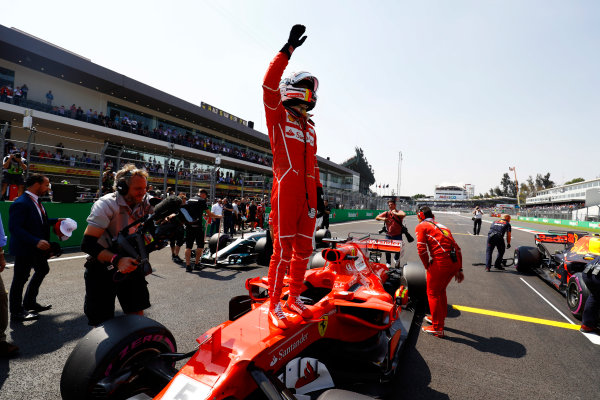 Autodromo Hermanos Rodriguez, Mexico City, Mexico. Saturday 28 October 2017. Sebastian Vettel, Ferrari, is filmed celebrating his pole position by standing on his car on the grid. World Copyright: Steven Tee/LAT Images  ref: Digital Image _O3I8409