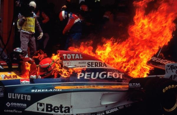 Eddie Irvine (GBR) and his mechanics were fortunate to escape injury when the Jordan 195 caught fire during a mid race pit stop. Formula One World Championship, Belgian Grand Prix, Spa-Francorchamps, Belgium, 27 August 1995. Catalogue Ref.: 10-059 Sutton Motorsport Images Catalogue
