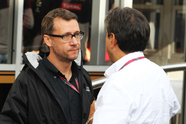 Eric Lux (FRA) Genii Capital CEO with Pasquale Lattuneddu (ITA) of the FOM.  Formula One World Championship, Rd 12, Belgian Grand Prix, Qualifying Day, Spa-Francorchamps, Belgium, Saturday 27 August 2011.