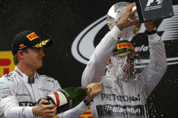 Circuit de Catalunya, Barcelona, Spain. Sunday 11 May 2014. Lewis Hamilton, Mercedes AMG, 1st Position, gets a soaking from Nico Rosberg, Mercedes AMG, 2nd Position, on the podium. World Copyright: Andy Hone/LAT Photographic. ref: Digital Image _ONY2194