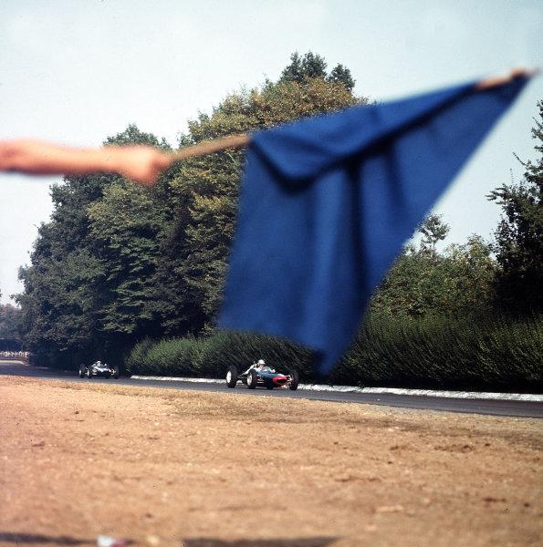 Monza, Italy.14-16 September 1962.Roy Salvadori (Lola Mk4 Climax) passes a blue flag.Ref-3/0676.World Copyright - LAT Photographic