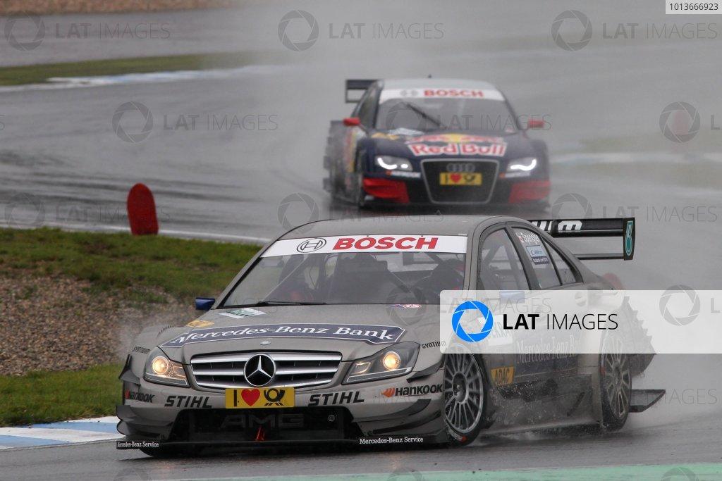 Bruno Spengler (CDN), Mercedes-Benz Bank AMG C-Klasse (2009) ahead of Mattias Ekstrom (SWE), Audi Sport Team Abt Sportsline, Red Bull Audi A4 DTM (2009).DTM, Rd8, Oschersleben, Germany, 16-18 September 2011 Ref: Digital Image dne1118se558