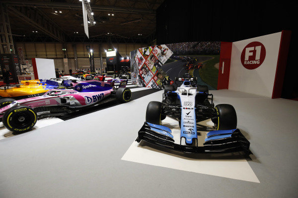 A Williams Racing FW42 next to a Racing Point RP19  on the F1 Racing stand