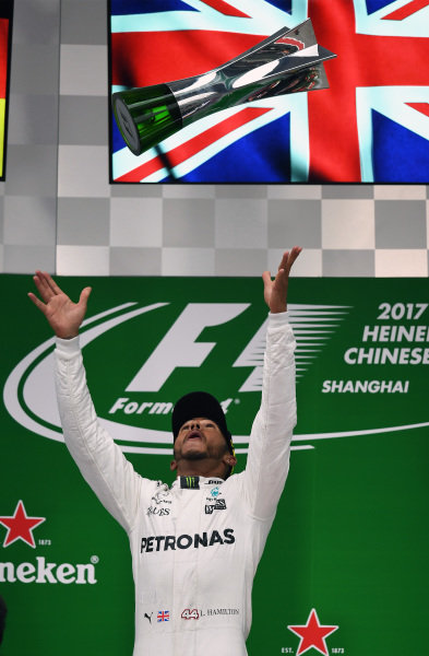 Race winner Lewis Hamilton (GBR) Mercedes AMG F1 celebrates on the podium with the trophy at Formula One World Championship, Rd2, Chinese Grand Prix, Race, Shanghai, China, Sunday 9 April 2017.