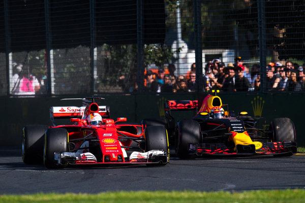 Sebastian Vettel (GER) Ferrari SF70-H and Max Verstappen (NED) Red Bull Racing RB13 battle at Formula One World Championship, Rd1, Australian Grand Prix, Race, Albert Park, Melbourne, Australia, Sunday 26 March 2017. BEST IMAGE