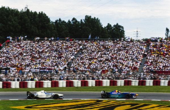 Johnny Herbert, Sauber C15 Ford, leads Mika Salo, Tyrrell 024 Yamaha.