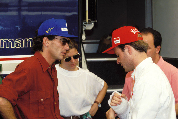 Ayrton Senna speaks to Rubens Barrichello after the latter's accident.