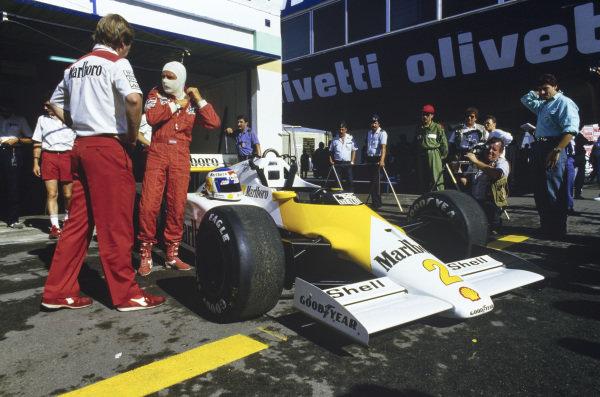 Keke Rosberg beside his McLaren MP4-2C TAG, running a one-off Marlboro Lights livery.