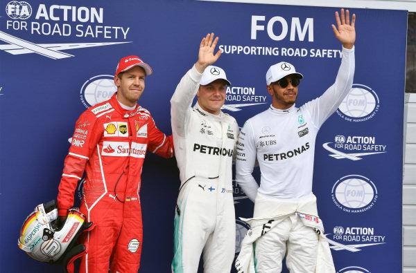 (L to R): Sebastian Vettel (GER) Ferrari, pole sitter Valtteri Bottas (FIN) Mercedes AMG F1 and Lewis Hamilton (GBR) Mercedes AMG F1 celebrate in parc ferme at Formula One World Championship, Rd9, Austrian Grand Prix, Qualifying, Spielberg, Austria, Saturday 8 July 2017.