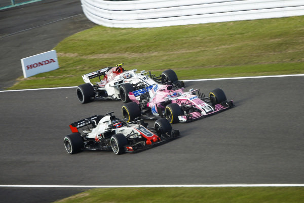 Romain Grosjean, Haas F1 Team VF-18, battles with Sergio Perez, Racing Point Force India VJM11 and Charles Leclerc, Sauber C37 Ferrari