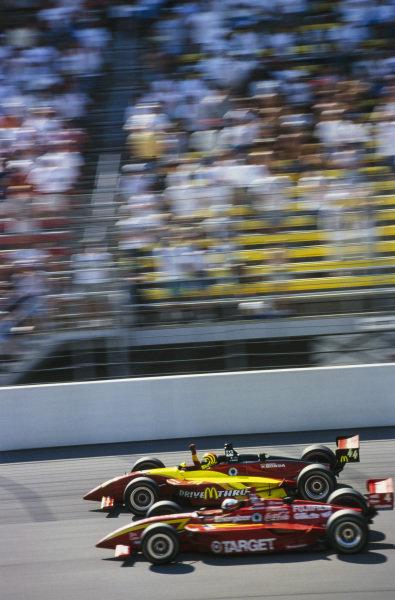 Tony Kanaan, Forsythe Racing, Reynard 99i Honda, celebrates as he crosses the finish line, ahead of Juan Pablo Montoya, Chip Ganassi Racing, Reynard 99i Honda.