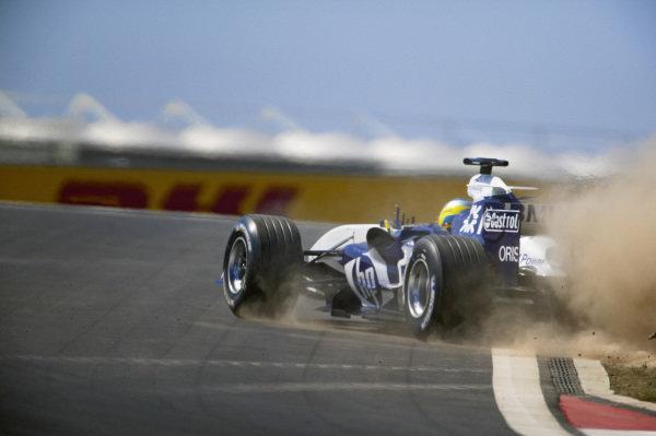 Nick Heidfeld, Williams FW27 BMW gets onto the grass.