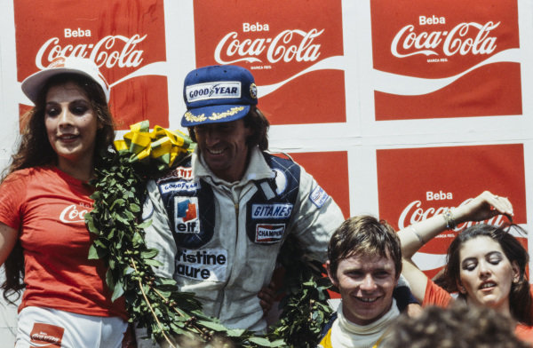 Jacques Laffite celebrates victory on the podium with Didier Pironi, 4th position. Pironi was initially award 3rd position as Carlos Reutemann was investigated for a push start.
