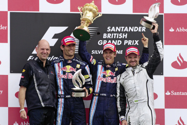 Podium group photo: Adrian Newey, Mark Webber, 2nd position, winner Sebastian Vettel, and Rubens Barrichello, 3rd position.