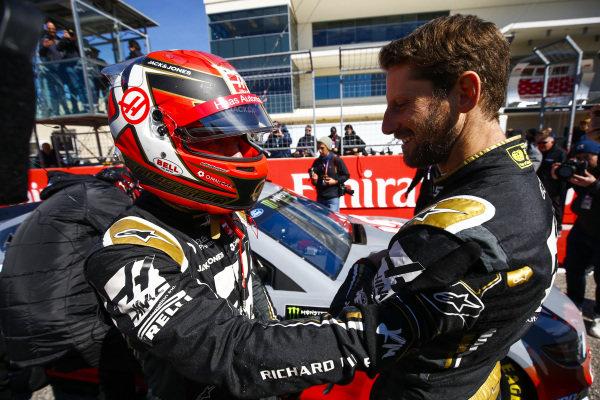 Romain Grosjean, Haas F1, and Kevin Magnussen, Haas F1, ride with Tony Stewart