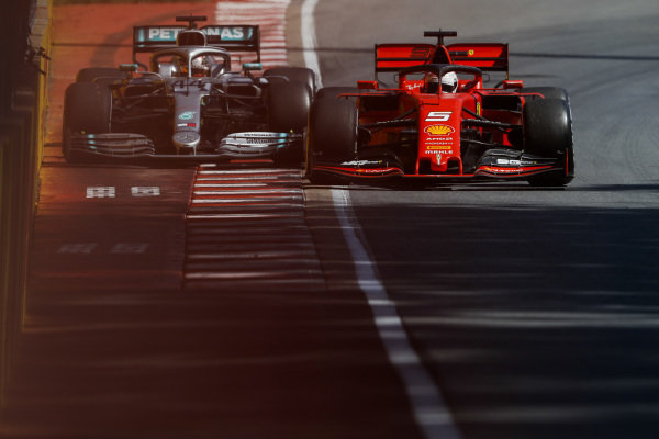 Sebastian Vettel, Ferrari SF90 and Lewis Hamilton, Mercedes AMG F1 W10 battle