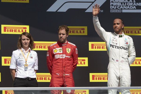 Sebastian Vettel, Ferrari, 2nd position, with Lewis Hamilton, Mercedes AMG F1, 1st position, on the podium