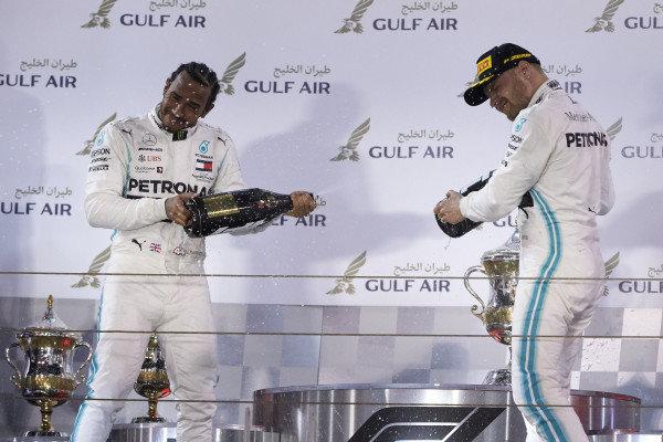 Lewis Hamilton, Mercedes AMG F1, and Valtteri Bottas, Mercedes AMG F1, spray champagne on the podium