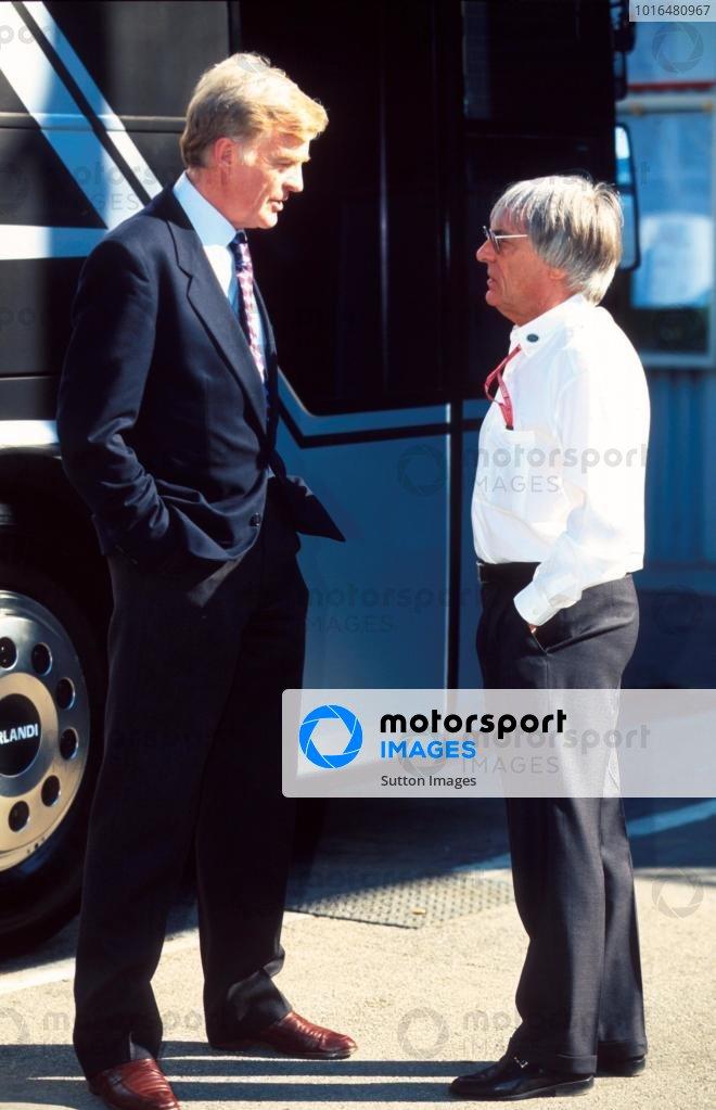 FIA president Max Mosley, left, talks with Bernie Ecclestone.