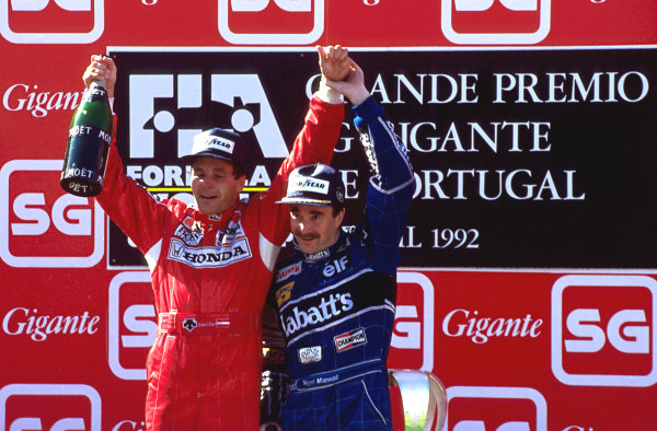 (L to R): Gerhard Berger (AUT) Ferrari and Nigel Mansell (GBR) Williams celebrate on the podium. Formula One World Championship, Rd14, Portugese Grand Prix, Estoril, Portugal, 27 September 1992.