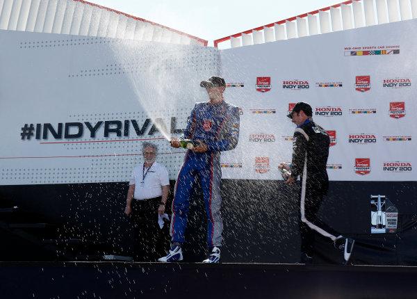 31 July - 2 August, 2015, Lexington, Ohio USA Justin Wilson and Simon Pagenaud celebrate with champagne on the podium  ?2015, Phillip Abbott LAT Photo USA
