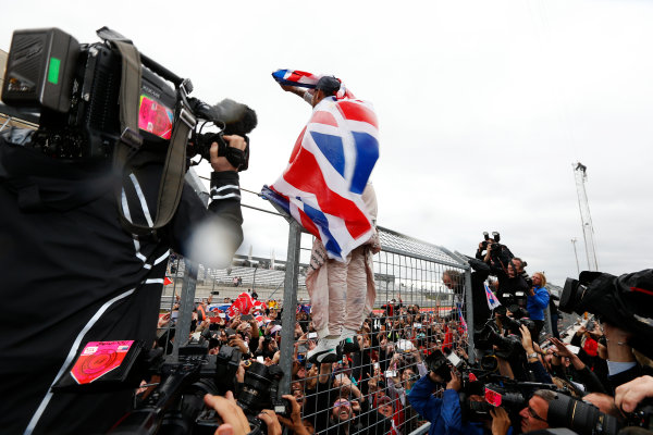 Circuit of the Americas, Austin, Texas, United States of America.  Sunday 25 October 2015. Lewis Hamilton, Mercedes AMG, 1st Position, celebrates with the fans. World Copyright: Charles Coates/LAT Photographic ref: Digital Image _J5R5327