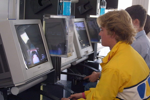 Nico Rosberg (FIN), son of former F1 driver Keke Rosberg, tries his skill at F1 racing on the Playstation 2.Formula BMW ADAC Championship, Rd5, Norisring, Germany. 30 June 2002.DIGITAL IMAGE