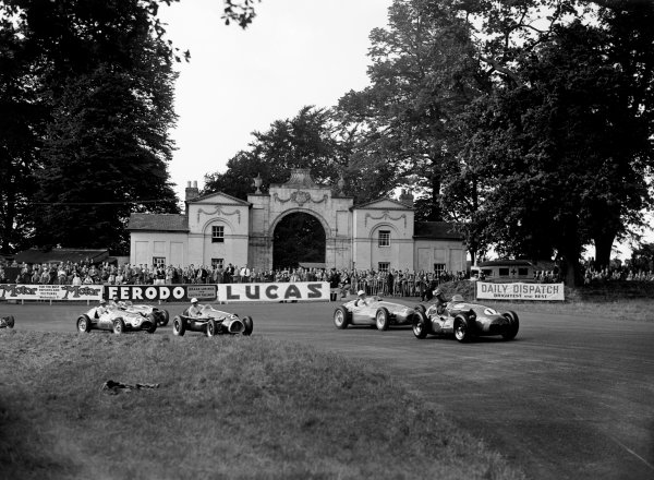 Oulton Park, Cheshire, England. 7th August 1954.Leslie Marr (Connaught A-Type), 7th position, leads Stirling Moss (Maserati 250F), 1st position, Alan Brown (Cooper-Bristol 23), retired, Reg Parnell (Ferrari 625), 2nd position and Ninian Sanderson (Cooper-Bristol 20), NC, action.World Copyright: LAT Photographic