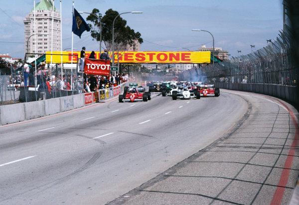1983 United States Grand Prix West  Long Beach, California, USA. 25-27th March 1983.  Patrick Tambay, Ferrari 126C2B, Keke Rosberg, Williams FW08C Ford, and Rene Arnoux, Ferrari 126C2B, lead at the start.  Ref: 83LB46. World copyright: LAT Photographic