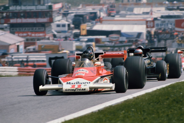 Osterreichring, Zeltweg, Austria. 13th - 15th August 1976.  James Hunt (McLaren M23-Ford), 4th position leads Mario Andretti (Lotus 77-Ford), 5th position, action.  World Copyright: LAT Photographic. Ref: 76 AUT 15.