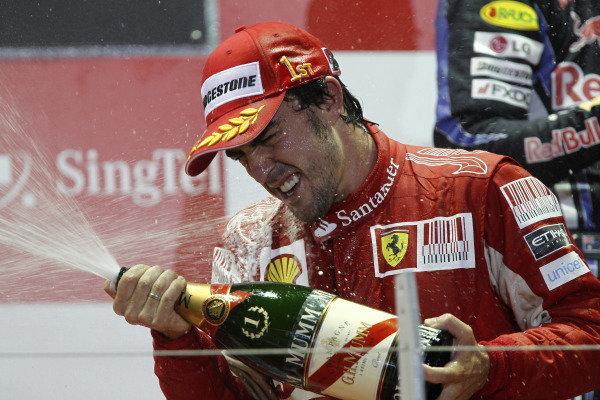 Marina Bay Circuit, Singapore. 26th September 2010. Fernando Alonso, Ferrari F10, 1st position, sprays the victory Champagne. Portrait. Podium.  World Copyright: Andrew Ferraro/LAT Photographic ref: Digital Image _Q0C6259