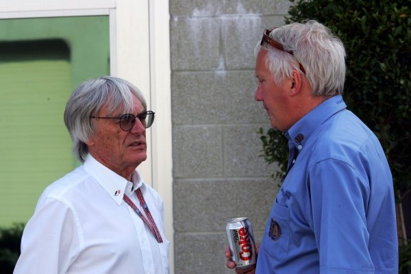 (L to R): Bernie Ecclestone (GBR) F1 Supremo talks with Charlie Whiting (GBR) FIA Delegate.
