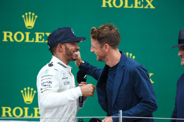 Silverstone, Northamptonshire, UK.  Sunday 16 July 2017. Jenson Button, McLaren, interviews Lewis Hamilton, Mercedes AMG, 1st Position, on the podium. World Copyright: Coates/LAT Images  ref: Digital Image AN7T3473