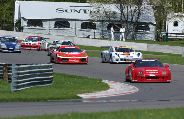 21-23 May, 2004, Mt. Tremblant, Quebec, CanadaPorsche's, Ferrari, Acura and BMW round turn 12 and 13 of the 15 turn, 2 65 mile circuit.C: 2004, Denis L. Tanney, USALAT Photographic